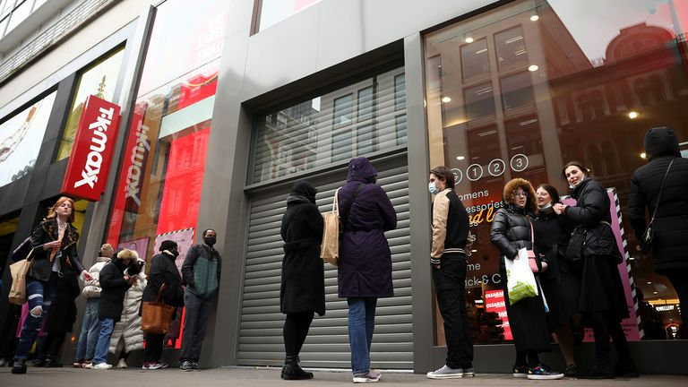 People stand outside an Oxford Street store, as coronavirus disease (COVID-19) restrictions ease, in London, Britain April 12, 2021. REUTERS / Henry Nicholls