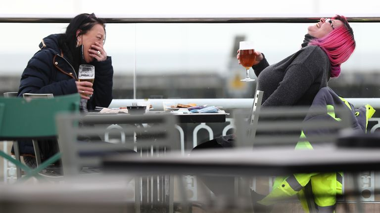 Pippa Ingram, 51, and Sue Bell, 55, were two of the first patrons of the UK's largest pub, the Royal Victoria Pavilion in Ramsgate, Kent.  Sipping on her pint, Ms Ingram said: 'Absolutely delicious'