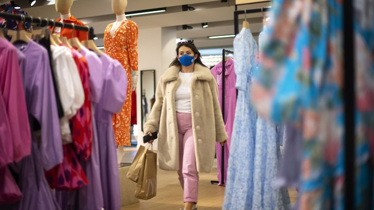 A shopper walks through the store as Selfridges reopen on Oxford Street, London, as England takes another step back to normal with the further easing of lockdown restrictions.  Photo date: Monday, April 12, 2021.