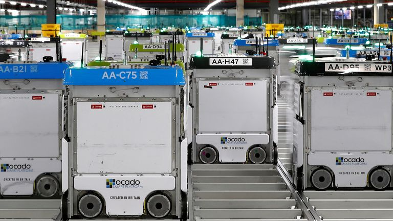 """""""Bots"""" are seen on the grid of the """"smart platform"""" at the Ocado CFC (Customer Fulfillment Center) in Andover, Great Britain on May 1, 2018."""