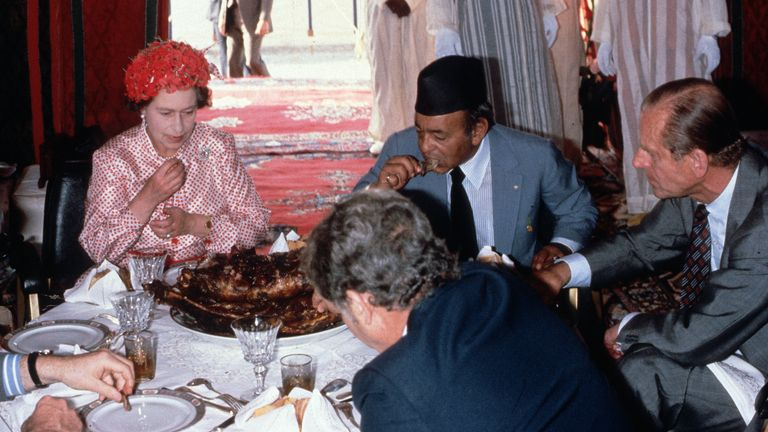 Prince Philip and the Queen eating lamb in Morocco.  Photo: Anwar Hussein