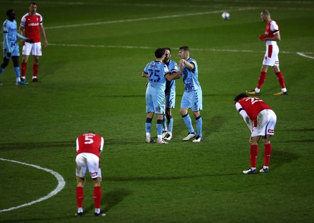 Coventry City's Matty James, Liam Kelly and Kyle McFadzean (left-right) celebrate after the final whistle as the Rotherham United players look dejected.  Photo: Tim Goode / PA Wire.