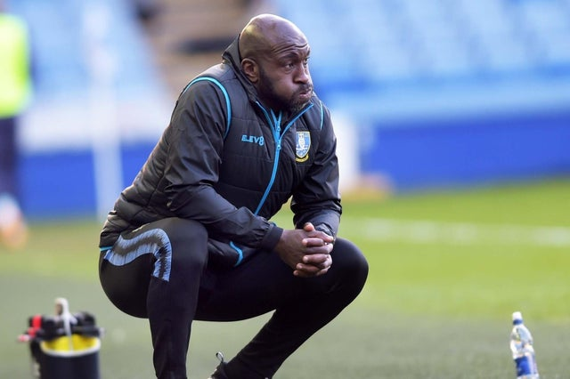 Sheffield Wednesday's Darren Moore has missed three games after testing positive for COVID-19.