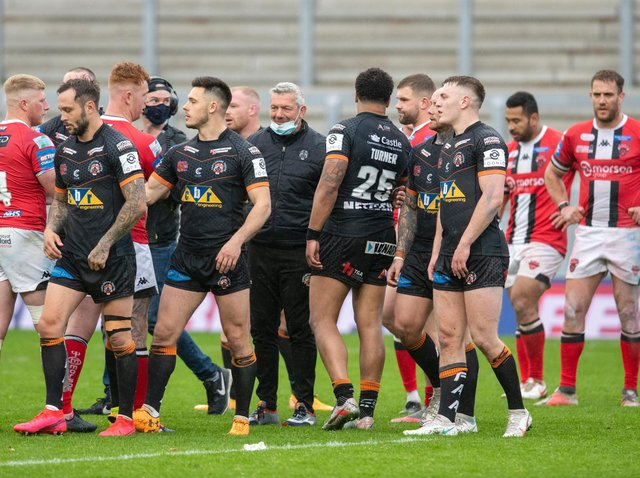 Coach Daryl Powell, center, with his Tigers players after the dramatic win over Salford.  Photograph by Tony Johnson.