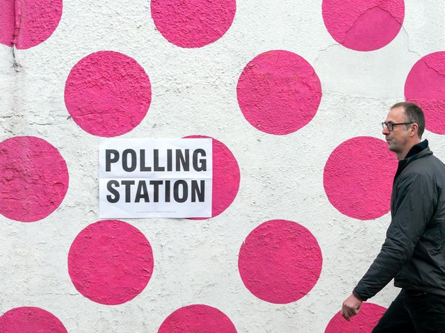 A man passes a polling station at the Bank View Cafe, Sheffield