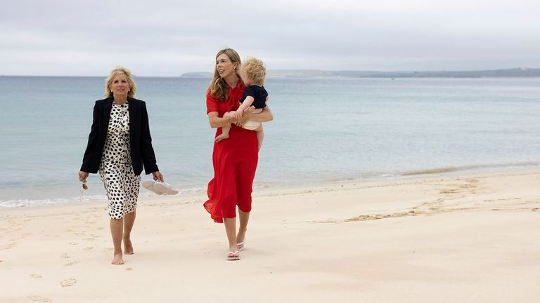 Carrie Johnson carries her son Wilfred as they are pictured on the beach with Jill Biden in Carbis Bay, Cornwall.  Photo: Flickr / Simon Dawson / No 10 Downing Street