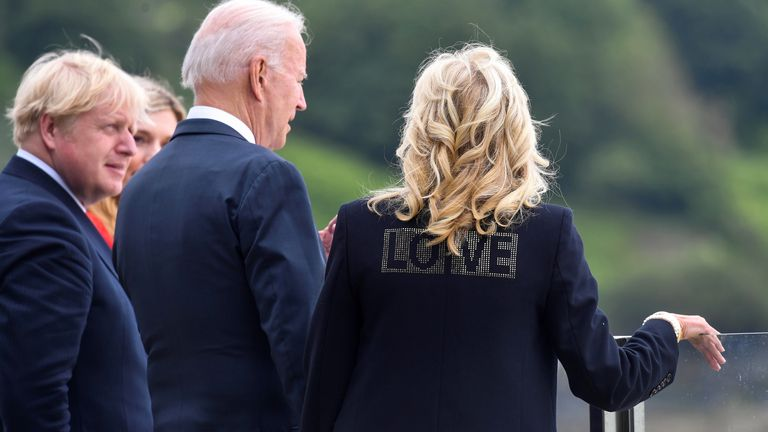 """Jill Biden wearing a jacket with the word """"Love"""" stands next to US President Joe Biden, UK Prime Minister Boris Johnson and his wife Carrie Johnson"""