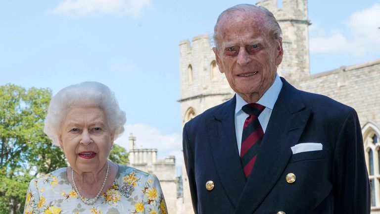 UNDER EMBARGO: Do not post or transmit before 10:00 PM BST on Tuesday, June 9, 2020. Queen Elizabeth II and The Duke of Edinburgh pictured 1/6/2020 in the Quadrangle of Windsor Castle before her 99th birthday on Wednesday.  Photo by the AP.  Issue date: Tuesday, June 9, 2020. The Queen wears an Angela Kelly dress with the Cullinan V diamond brooch. The Duke wears a Household Division tie.  See PA ROYAL Philip's story.  Photo credit should read: Steve Parsons / PA Wire