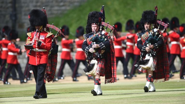 Members of the Massed Band of the Household Division perform at the ceremony at Windsor Castle
