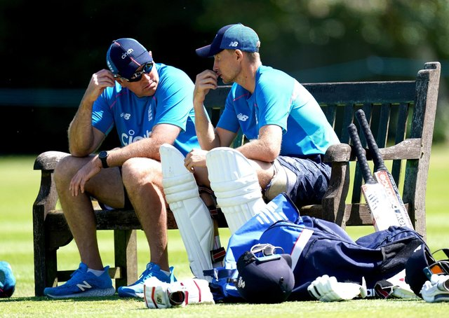 Careful whispers: England captain Joe Root, right, and coach Chris Silverwood, left, share some thoughts during a break in the nets session in Edgbaston yesterday.  (Image: PA)