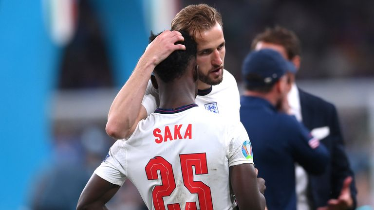 Soccer Football - Euro 2020 - Final - Italy v England - Wembley Stadium, London, Great Britain - July 11, 2021 England's Harry Kane with Bukayo Saka after the Pool match via REUTERS / Laurence Griffiths